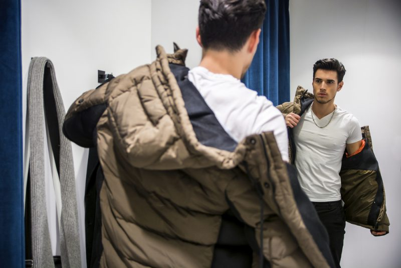 Man Trying on Clothes