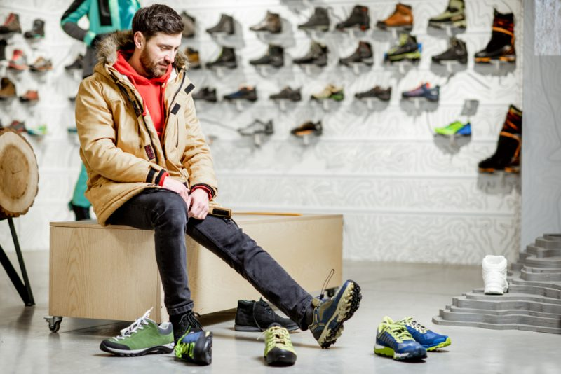 Man Trying on Shoes in Store