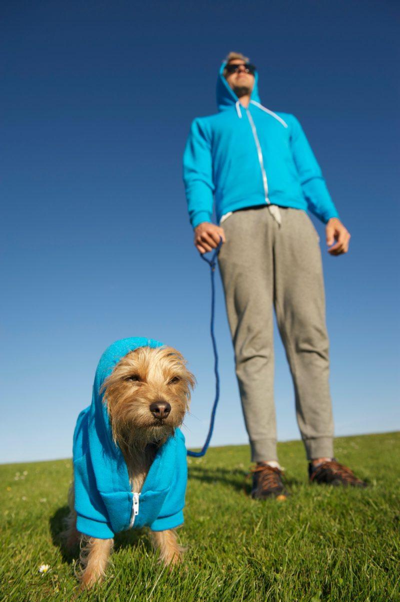 Man Walking Dog Wearing Hoodie