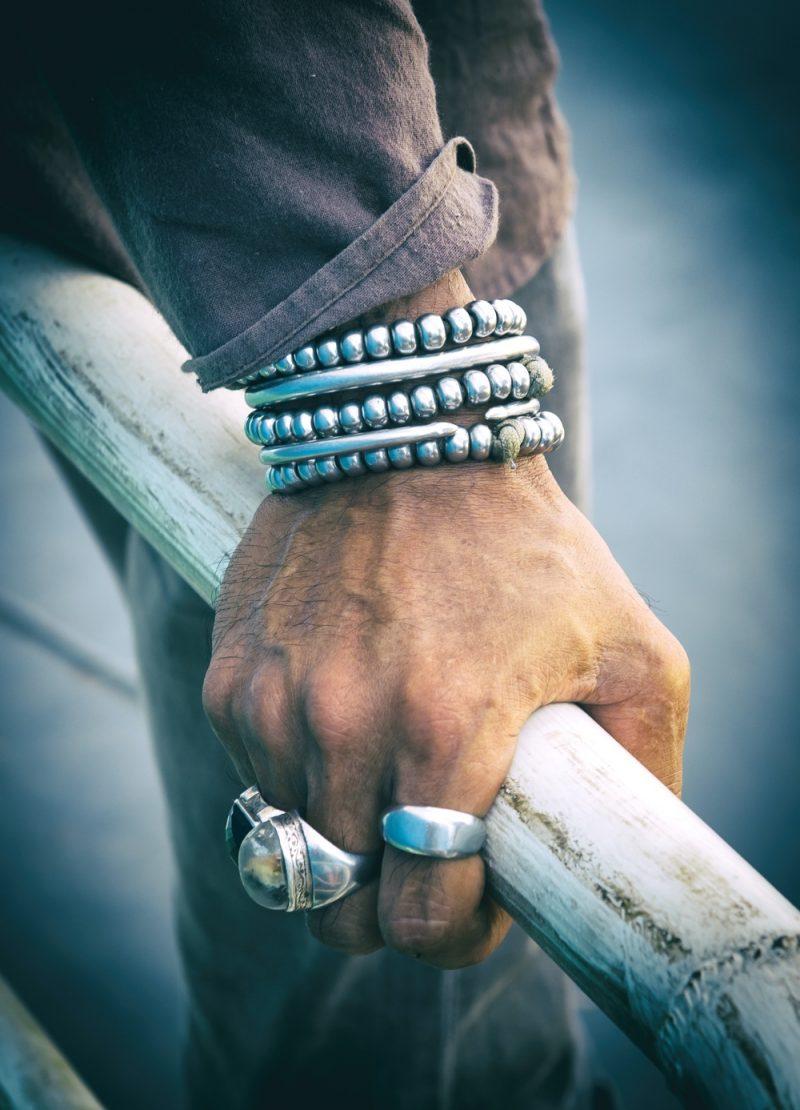 Man Wearing Silver Jewelry