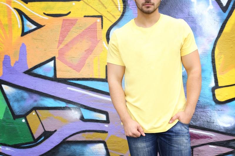 Man Yellow T-Shirt Jeans Graffiti Background