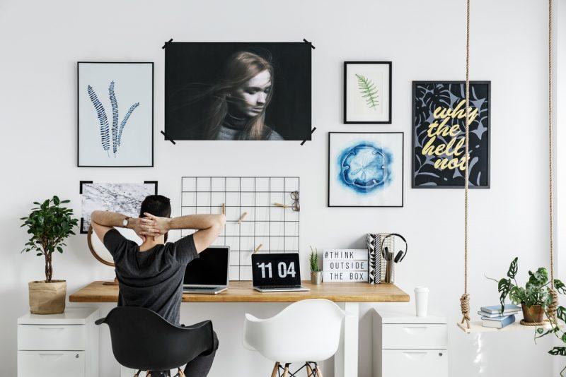 Man at Desk Artwork on Wall