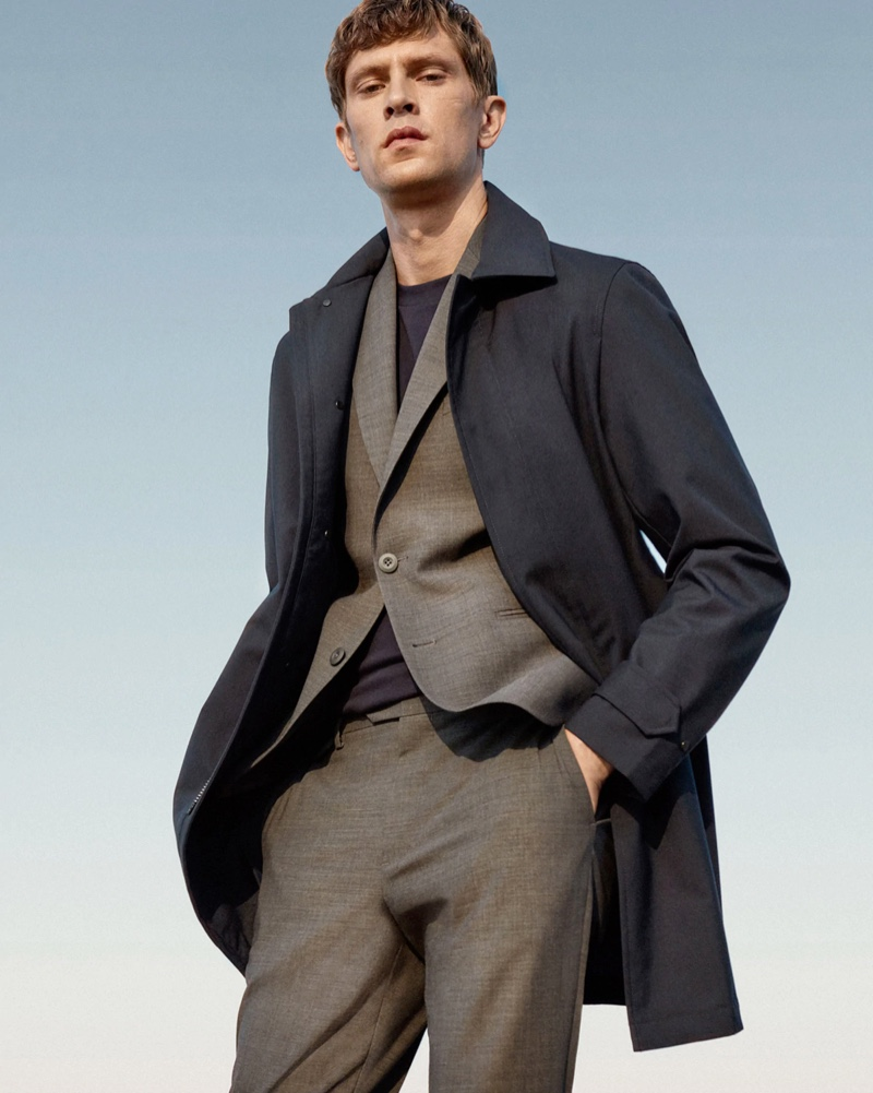 Front and center, Mathias Lauridsen models a gray suit with a navy coat from Mango's Improved collection.