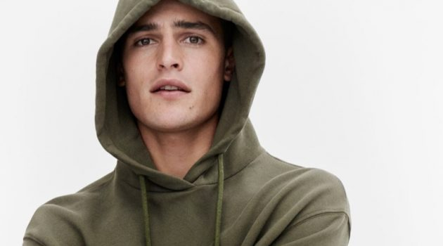 Parker van Noord rocks a green hoodie for Marc O'Polo's fall-winter 2020 campaign.