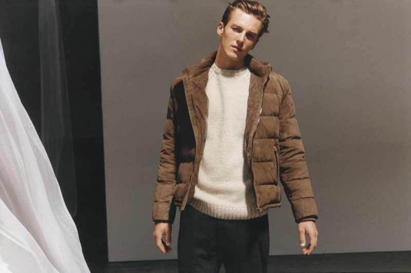 Quentin Demeester wears a brown puffer jacket with a crewneck sweater from Massimo Dutti's fall-winter 2020 Limited Edition men's collection.