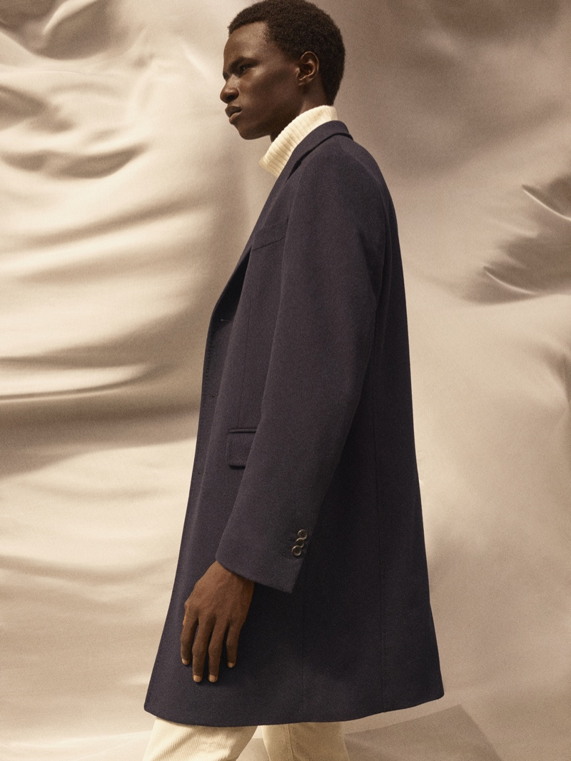 Malick Bodian dons a sleek coat and ribbed turtleneck sweater from Massimo Dutti's fall-winter 2020 Limited Edition men's collection.