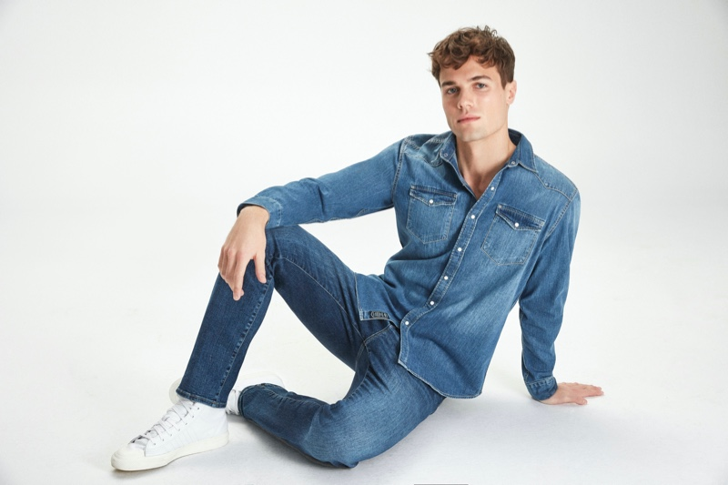 Doubling down on denim, Jacques Stephan Pougnet models a denim shirt and distressed jeans from Mavi's fall-winter 2020 collection.