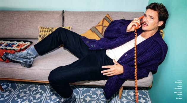 Taking a phone call, Pedro Pascal dons a cardigan sweater by Givenchy. Posing for GQ Germany, Pascal's look is complete with Junya Watanabe pants, a POLO Ralph Lauren tank, and vintage boots.
