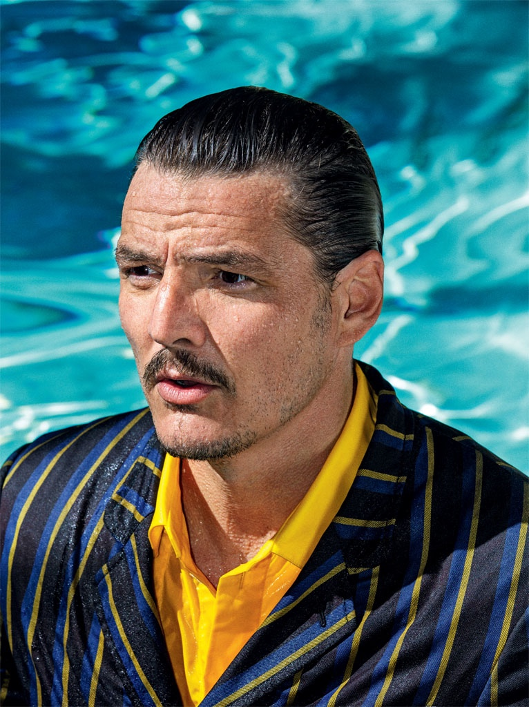 Relaxing poolside with GQ Germany, Pedro Pascal wears a pinstripe Lanvin suit with an Off-White shirt.