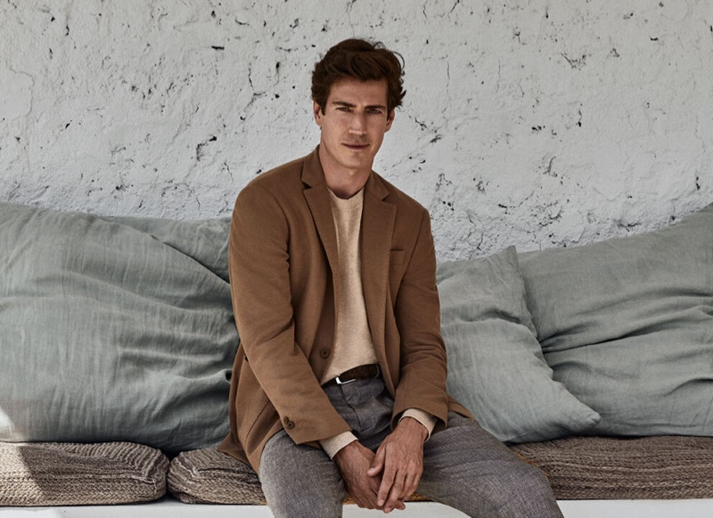 Oriol Elcacho dons a smart suit jacket over a crewneck sweater with trousers from Pedro del Hierro's pre-fall 2020 collection.