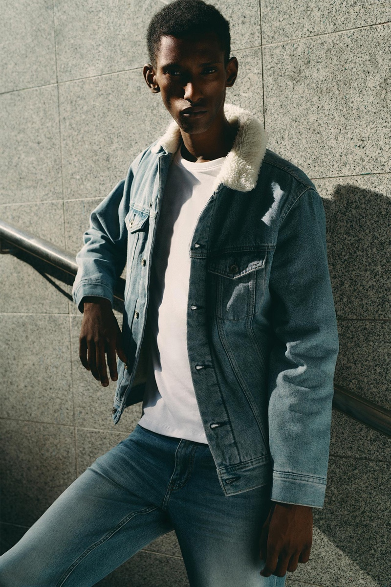 Doubling down on denim, Myles Dominique wears Reserved.