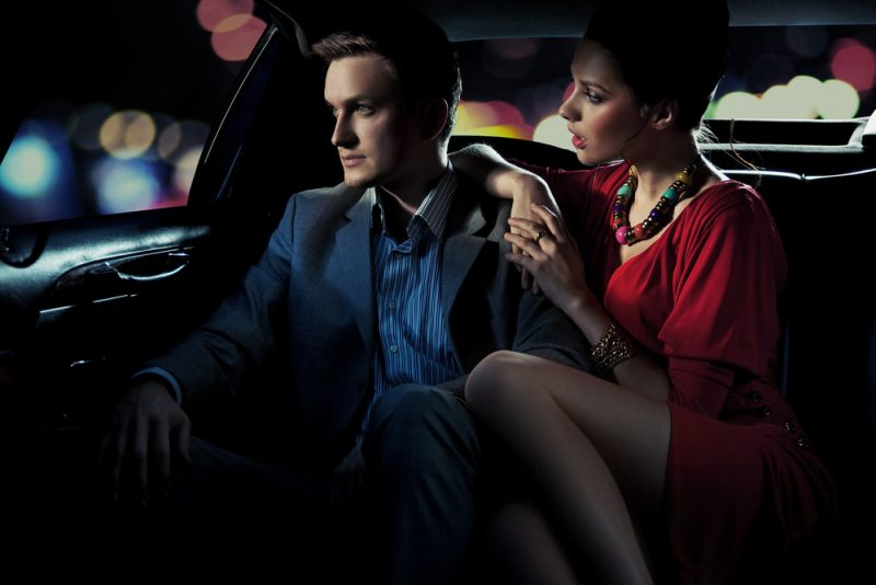 Stylish Couple in Back of Limo
