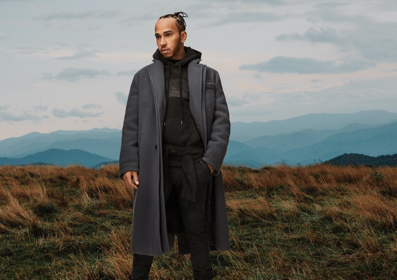 Front and center, Lewis Hamilton embraces monochromatic style in a black and gray look from his fall-winter 2020 TommyxLewis collection.