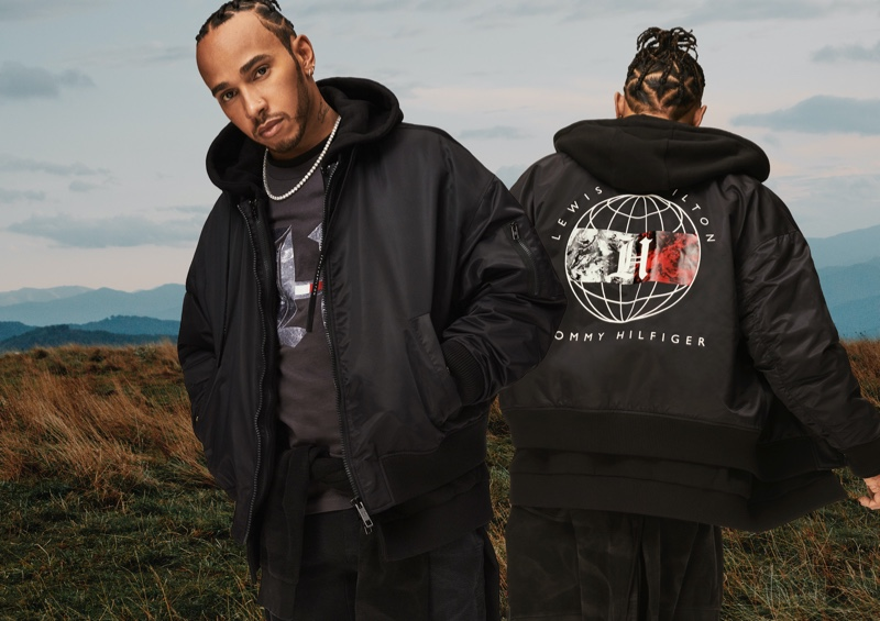 Tommy Hilfiger global brand ambassador Lewis Hamilton sports a black bomber, which is part of his fall-winter 2020 TommyxLewis line.