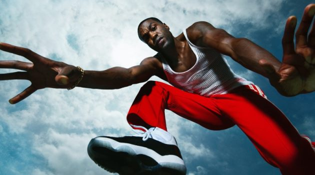 Dana Scruggs photographs Yahya Abdul-Mateen II for Men's Health. He wears a vintage mesh tank with Wales Bonner track pants and Jordan sneakers.