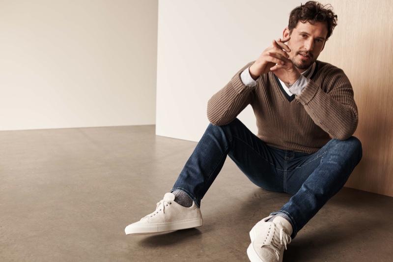 British model Sam Webb wears 34 Heritage's Cool mid organic jeans.