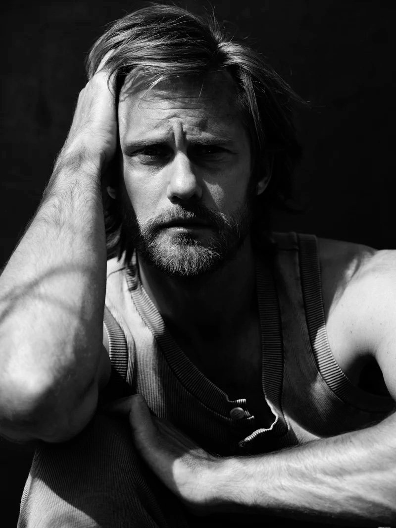 Appearing in a black and white image for L'Uomo Vogue, Alexander Skarsgård dons a look from Dolce & Gabbana.