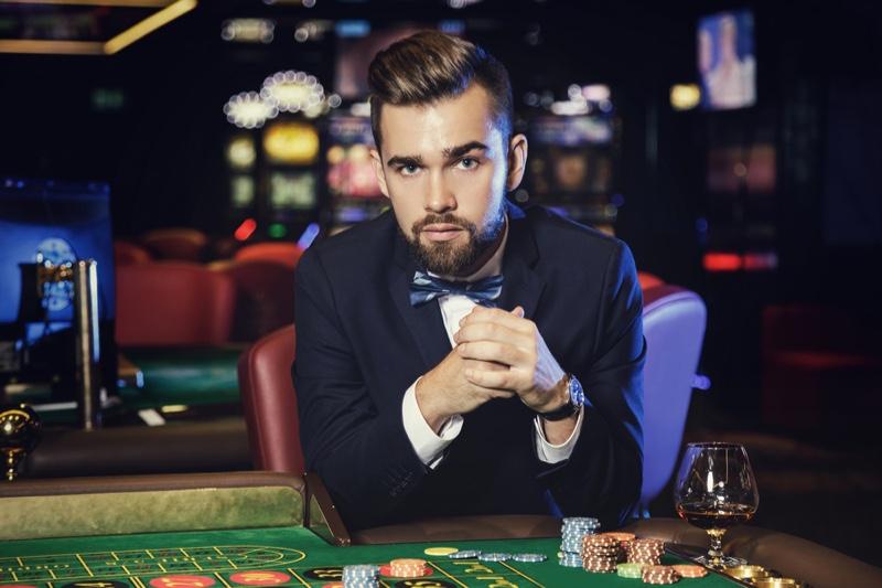Attractive Man Suit Bow Tie Casino Table