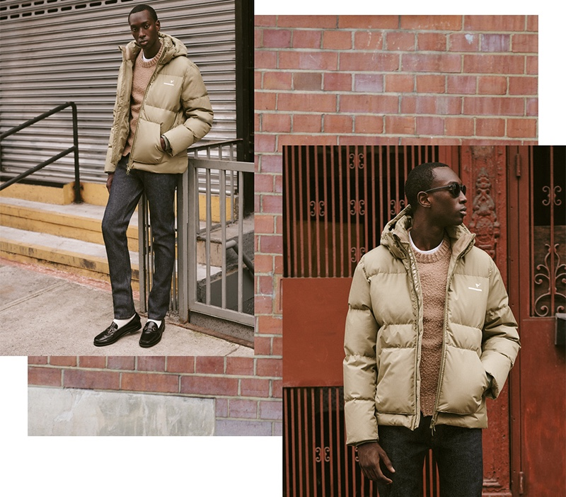 Puffer Up: A cold weather classic, the puffer jacket takes the spotlight with The Arrivals' AER alpine down puffer jacket. Stepping outdoors, Macky Dabo wears it with a Maison Margiela sweater, Banks Journal check pants, and Sebago Classic Joe loafers. The look playfully brings together casual and formal styles.