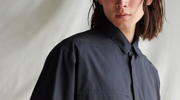 Olie Arnold styles an oversized shirt with a braided leather belt from the Fear of God for Ermenegildo Zegna collection.