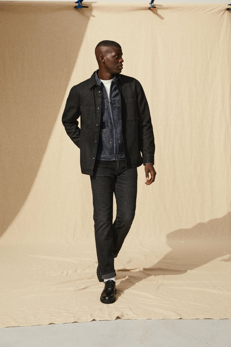Hitting the studio, model Evandro Laurens showcases denim fashions from H&M's Jeans Redesign collection.