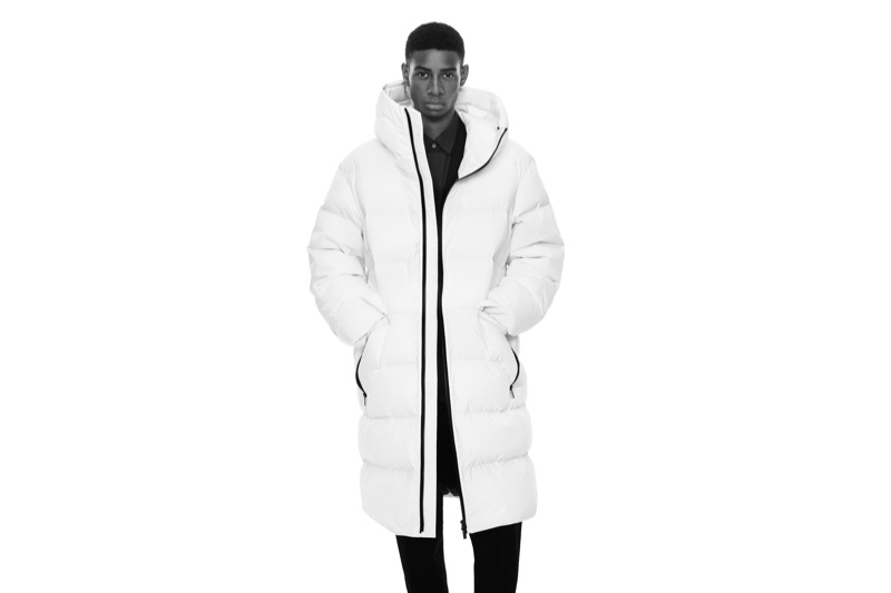 Ready to turn heads, Louis Dicko wears a white puffer coat for the fall-winter 2020 UNIQLO +J campaign.