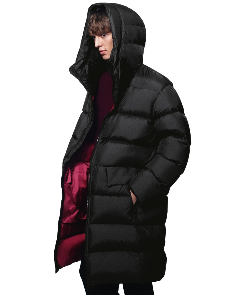 Dressed for the cold, Leon Dame sports a hooded puffer from the fall-winter 2020 UNIQLO +J collection.