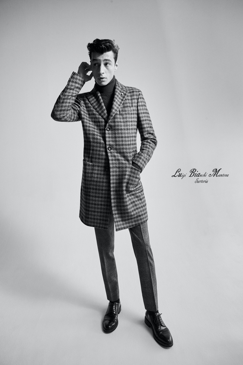 Front and center, Adrien Sahores hits the studio in a houndstooth coat from Luigi Bianchi Mantova's fall-winter 2020 collection.