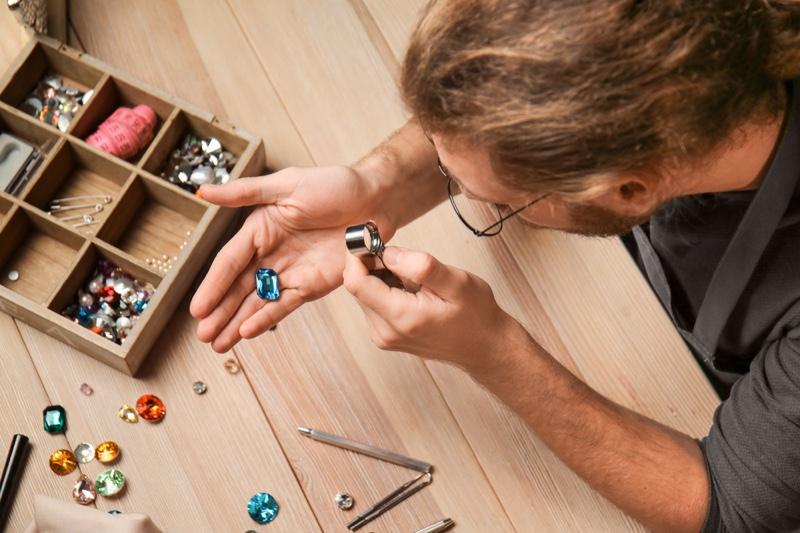 Man Examining Gemstones Jeweler