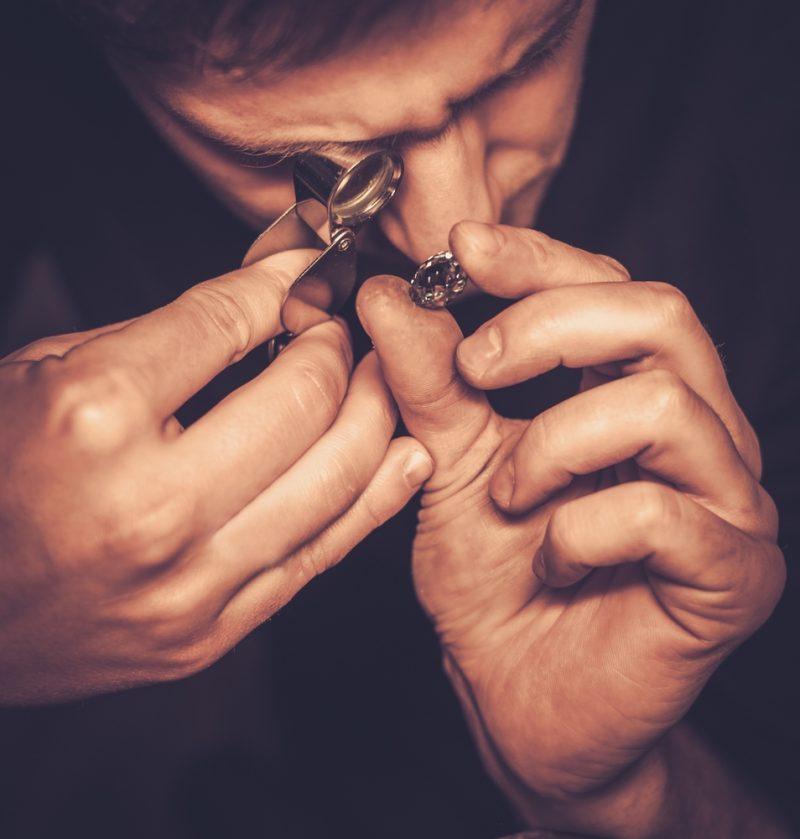 Man Inspecting Diamond
