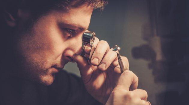 Man Studying Diamonds Jeweler Examiner