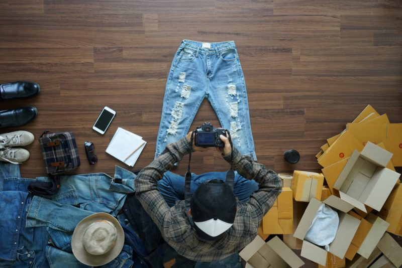 Man Taking Photos of Jeans