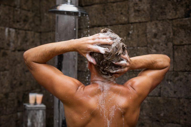 Man Washing Hair and Conditioning