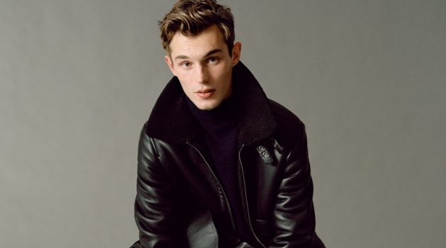 Kit Butler embraces contemporary style in a look from Mango's fall-winter 2020 Urban Essentials collection. The British model takes to the studio where he sits for a portrait. He dons a Mango leather jacket with slim-fit pants, a turtleneck, and leather boots.