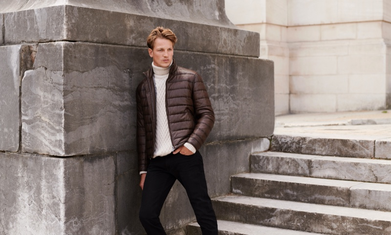 Going casual, Hugo Sauzay sports a turtleneck cable-knit sweater with a quilted jacket from Massimo Dutti.