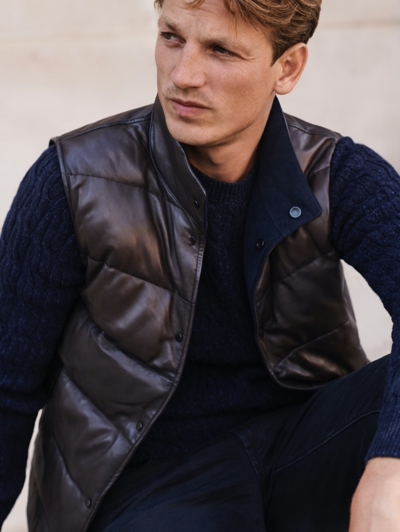 Reuniting with Massimo Dutti for a fall editorial, Hugo Sauzay dons a quilted vest with a cable-knit sweater.