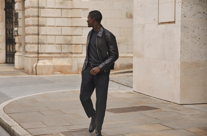 Wearing a leather jacket, James Kakonge models a fall-winter 2020 look from Mr Porter's Mr P. label.