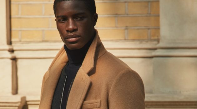 James Kakonge dons a sleek camel coat from Mr Porter's fall-winter 2020 Mr P. collection.