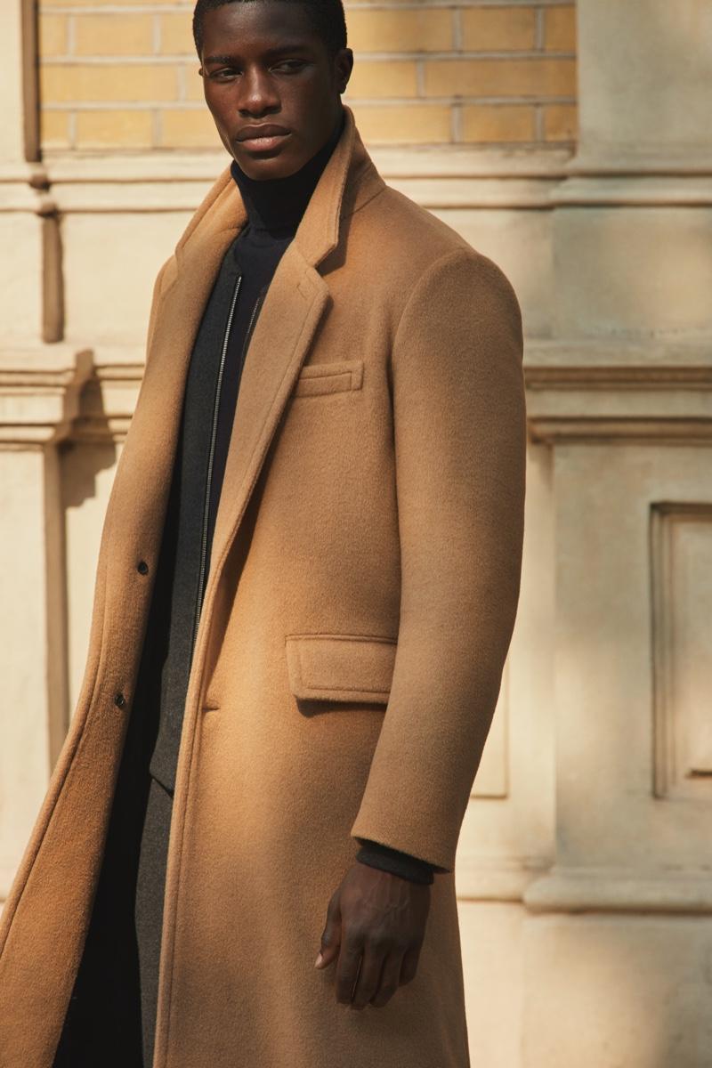 James Kakonge dons a sleek camel coat from Mr Porter's fall-winter 2020 Mr P. collection.