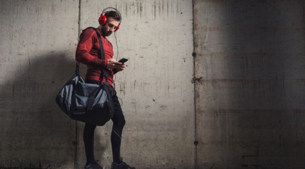 Muscular Man Stylish Outfit Gym Bag Headphones