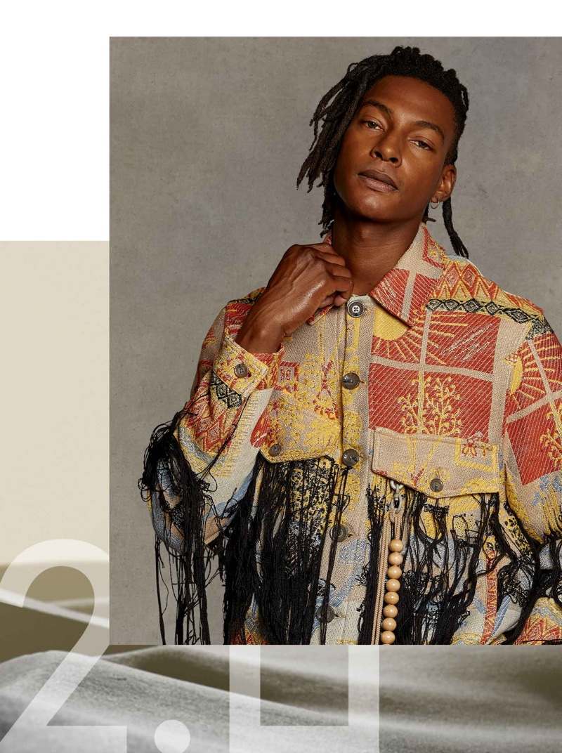 Making a graphic statement, all while embracing washed out tones, Ty Ogunkoya wears a jacquard military jacket from Song for the Mute.