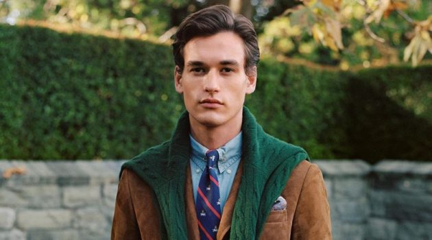 Jegor Venned is a posh vision in fall menswear from POLO Ralph Lauren. The top model dons a brown suede blazer with a POLO denim shirt and cable-knit sweater in green.