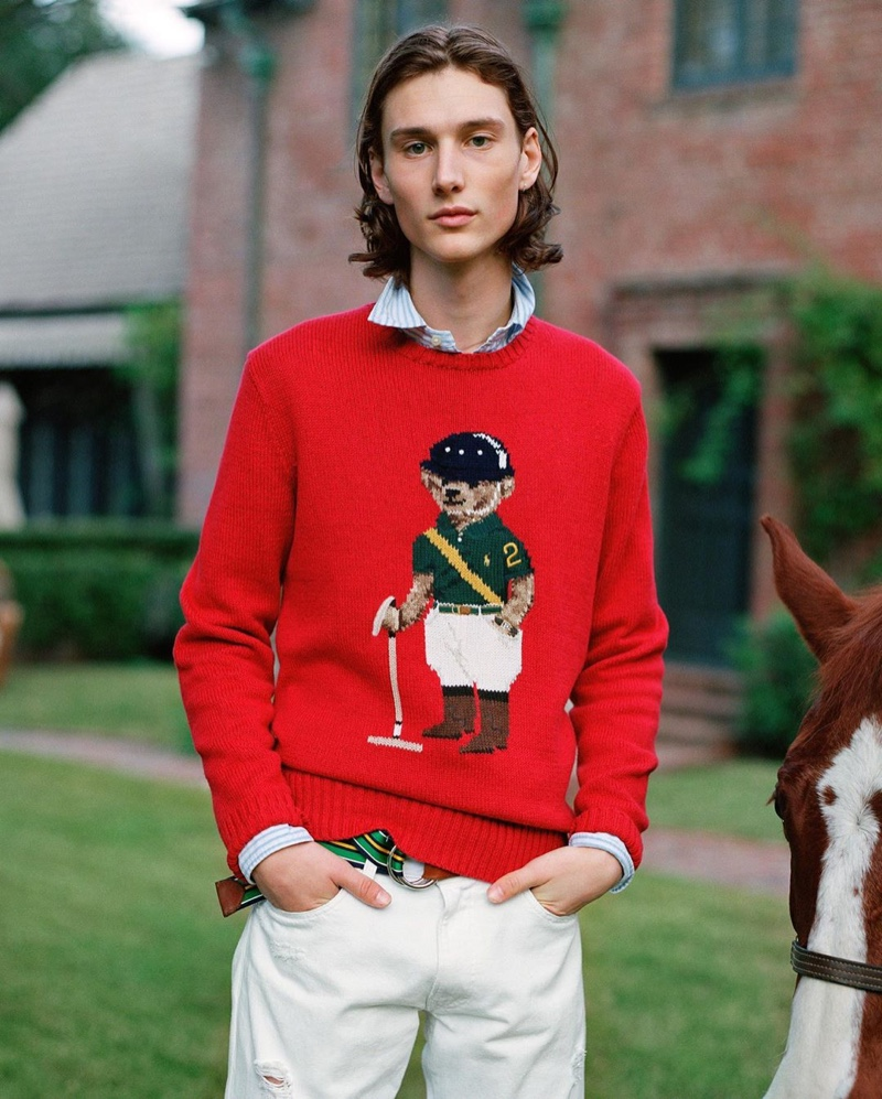 Wellington Grant dons POLO Ralph Lauren's red Riding Bear sweater from the brand's fall 2020 collection.