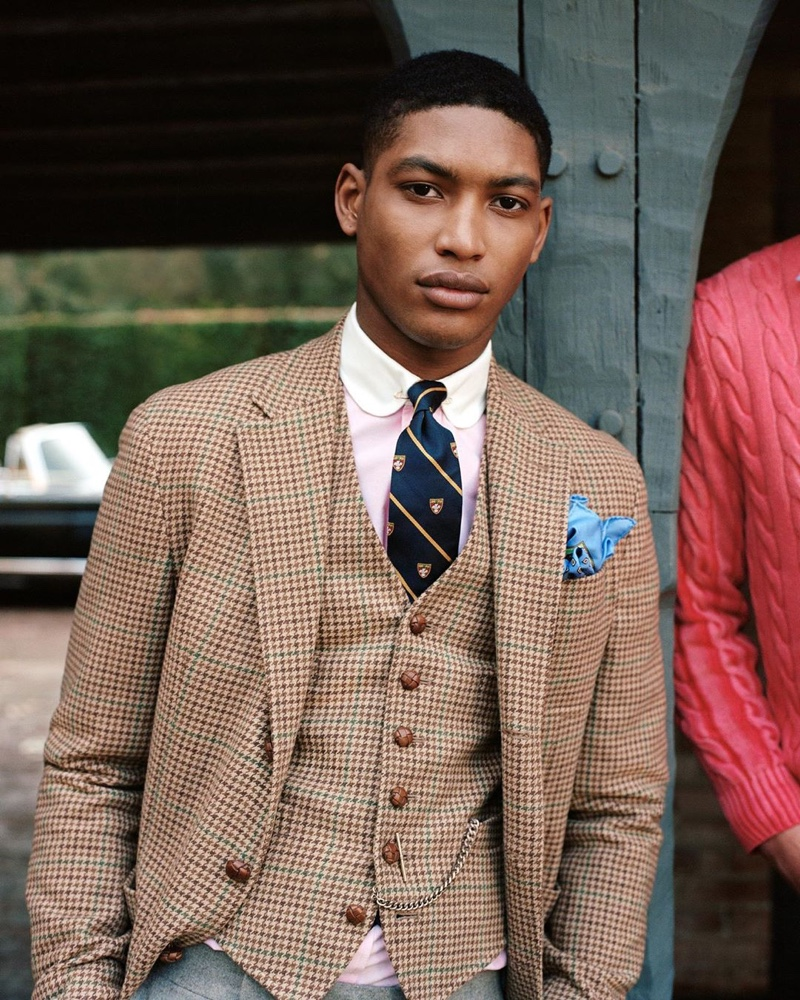 Timothy Lewis sports a matching waistcoat and blazer from POLO Ralph Lauren's fall 2020 collection.