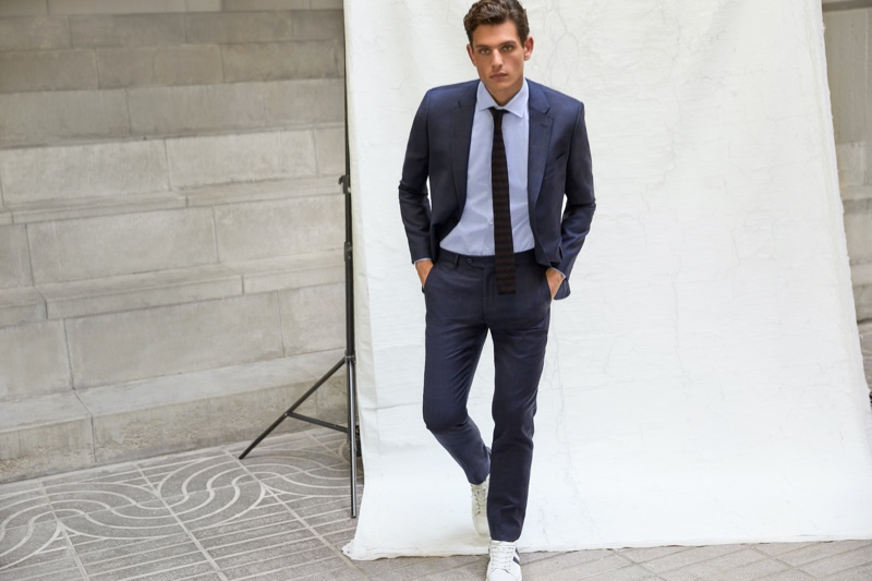 Model Pau Ramis dons a sharply tailored suit from Roberto Verino's fall-winter 2020 menswear collection.