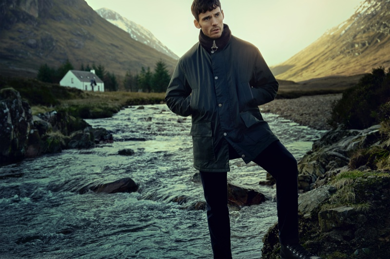 Barbour Gold Standard enlists Sam Claflin as the face of its fall-winter 2020 campaign. Posing for a photo, Claflin dons the brand's Supa Border wax jacket.