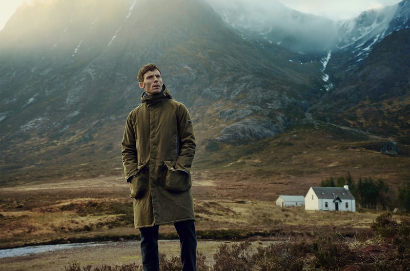 Keeping warm in Barbour Gold Standard's Supa Hunting wax jacket, Sam Claflin fronts the fall-winter 2020 campaign.