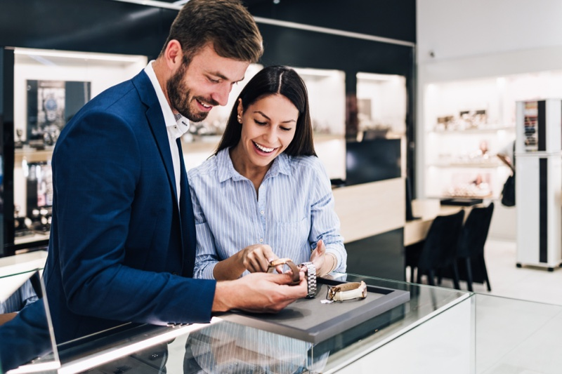 Smiling Couple Looking Jewelry Store