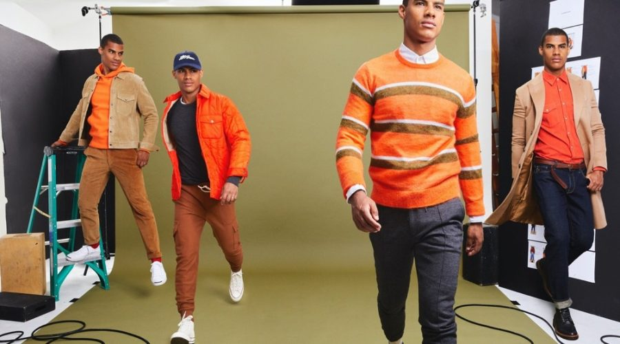 Vitor Melo makes a colorful statement in orange fashions from Todd Snyder's fall-winter 2020 collection. Pictured left to right: Vitor wears a Todd Snyder + Champion lightweight popover hoodie sweatshirt, Todd Snyder Italian quilted liner jacket, striped mohair sweater, and micro corduroy western shirt in orange.