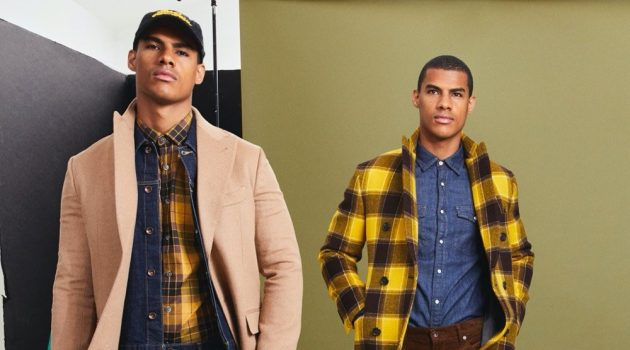 Clad in yellow and checks, Vitor Melo is ready to turn heads in Todd Snyder's Italian Buffalo plaid two-collar topcoat and mustard plaid flannel button-down shirt.